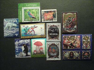 10 Latvia stamps. Ship, people, sport, nature,... Used.