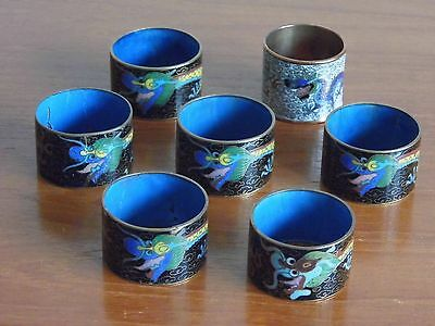 Six Antique Chinese Cloisonné black napkin rings and one other