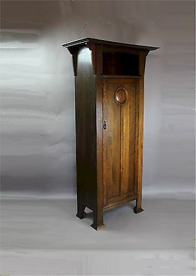Arts and Crafts oak hall cupboard / wardrobe c1900