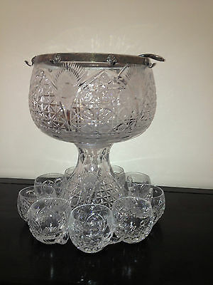 Cut glass punch bowl c/w 6 cut glass cups and silver Plated ladle
