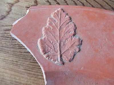 Roman.   A Large Red Ware Pot Sherd With A Leaf Design    Nice Condition.