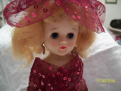 vogue jill doll with Christmas red sparkle gown, leopard print gown, hats