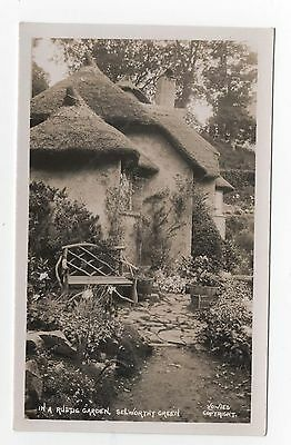 Original RPPC - Real Photo postcard - In a Rustic Garden - Selworthy - Somerset