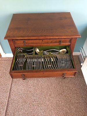Oak wood table with cutlery drawers and cutlery canteen