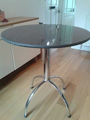 small granite top table and 2 chairs
