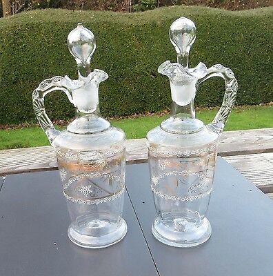 A Pair of Pretty Antique Hand Blown Glass Claret Jugs with Enamel and Gilding