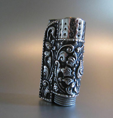 Ca. 1930s: A GREAT AUSTRIAN IMCO PETROL LIGHTER WITH LOTUS FLOWERS