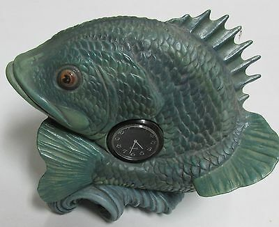 Large Green Fish With Clock