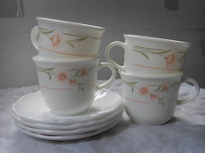 Pyrex tea set with a pink flower design 4 cups and 4 saucers