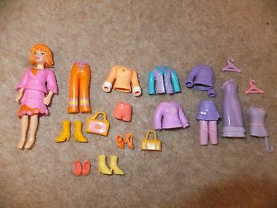 polly pocket doll and clothes Very good condition