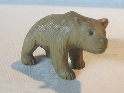 Vintage hand carved wooden bear figurine with glass eyes
