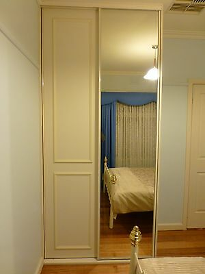 Mirrored wardrobe with panelled door and shelving