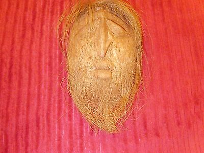 carved coconut shell mask  wall hanging