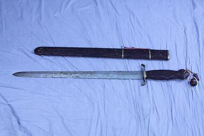 Asian sword with carved wood scabbard