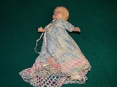 Antique baby doll with hand sewn dress in good shape!!!