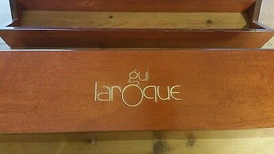 wooden box of Gui Laroque ties and cufflinks