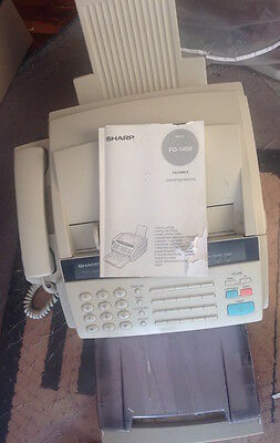 Sharp fax/phone/copier with  manual & 1 spare roll of imaging film