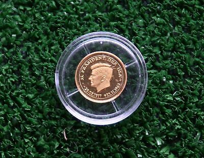 Treasures in Gold - 1/20oz gold coin of John F Kennedy with COA