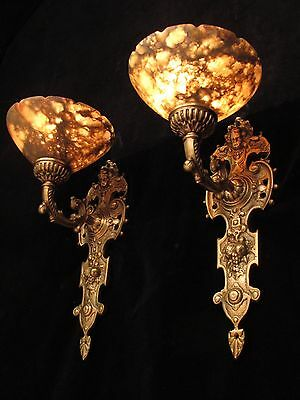 wall light sconces angel faces  solid cast bronze custom made by local artist