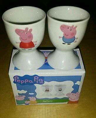 Peppa pig and george egg cup set (2). New in box.