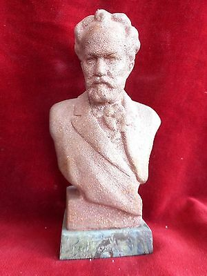 Bust of the composer Tchaikovsky plated red metal on a marble stand
