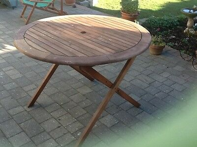 round hardwood garden patio table FSC 108 Cm wide 2 years old folding