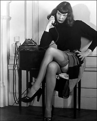 Bettie Page Skirt pulled up talking on phone  5 x 7 Photograph