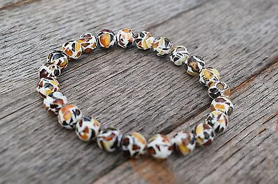 Genuine Baltic Amber Bracelet. Handmade natural amber pieces in white clay.