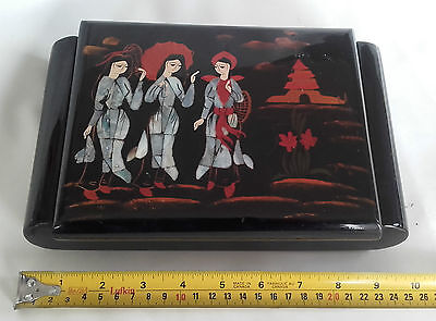 Oriental lacquered / shell inlaid musical jewellery box.