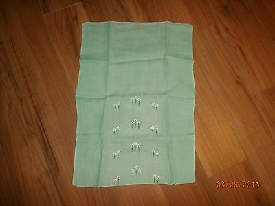 vintage light green embroidered tea towel with daisies