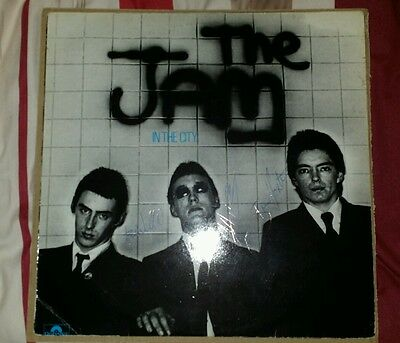 The Jam signed LP In the city by Paul Weller, Rick Buckler and Bruce Foxton.