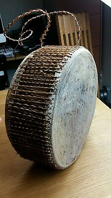 African tribal drum . Skin membrane. Leather twine . Twine strap.