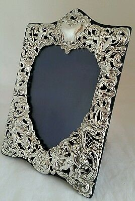 A quality pierced sterling silver photograph frame.London1901.By William Comyns