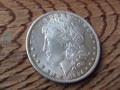 United States.  1884, Silver Dollar.        Superb Condition.