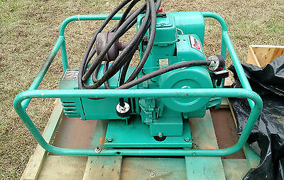 Onan gas pwered 5.5Kw portable Generator on casters backup power
