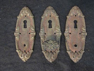 Three Antique Key Hole Covers, One Complete with Pull