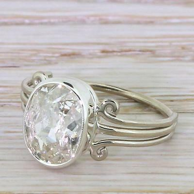 ART DECO OLD OVAL CUT DIAMOND SOLITAIRE ENGAGEMENT RING - 18k W. Gold - c 1935