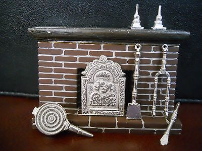 minature dollhouse fireplace with pewter accessories