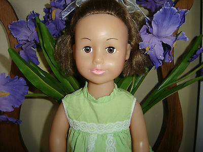 "2013 Uneeda Vinyl And Cloth 18"" Doll Brown Hair, Brown Eyes, Green Dress, Shoes"