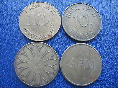4 X Different Gold Coloured 10P Tokens Jpm, Bell Fruit, Peter Simper Coins
