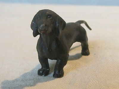 Vintage cast metal Dachshund dog figurine with a black painted finish