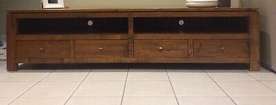 Timber entertainment unit with four storage draws