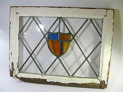 Antique Stained Glass Window with Shield