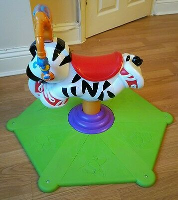 Fisher Price Go Baby Go Bounce and Spin Zebra toy musical bouncer