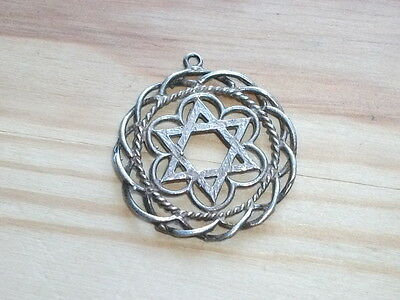 A Hebrew Star Of David Silver Pendant