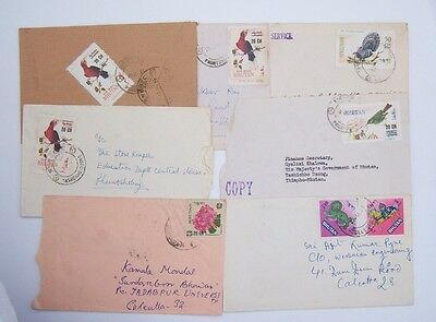 7 Covers from Bhutan.  Mostly Bird's including a Peacock, a couple with frowers.