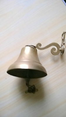 Brass Hanging Bell With Wall Mounting.