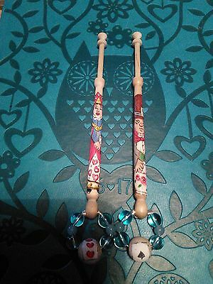Pair Of Lace Bobbins With An Alice In Wonderland Theme