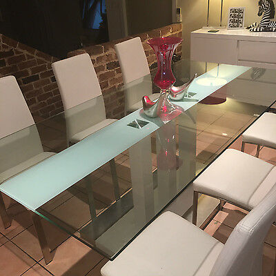 Glass dinning table and white dinning chairs