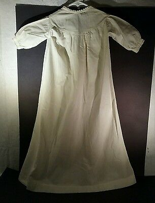 Antique infant nightgown with string lace edging